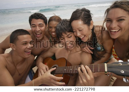 Multi-ethnic friends at beach - stock photo