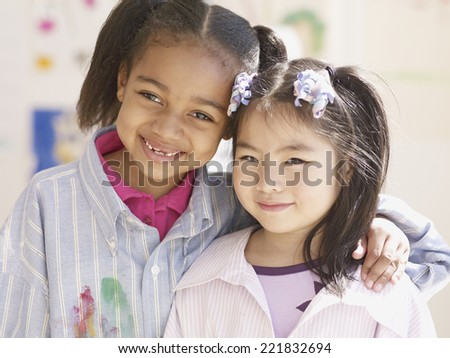 Multi-ethnic girls hugging - stock photo