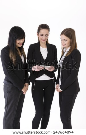 Multi-ethnic group of Asian and Caucasian businesswomen using smartphone. Isolated on white background. - stock photo