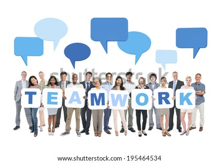 Multi-Ethnic Group Of Business And Casual People Holding Cardboards Forming Teamwork And Empty Speech Bubbles Above. - stock photo