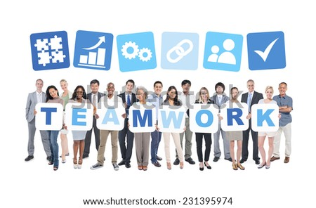 Multi-ethnic group of business and casual people holding cardboards forming teamwork and related symbols above. - stock photo