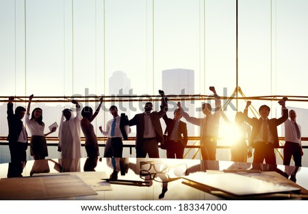 Multi-Ethnic Group Of Business People Celebrating In Board Room - stock photo
