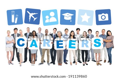 Multi-Ethnic Group Of Business People Holding Placards That Form Careers And Related Symbols Above - stock photo