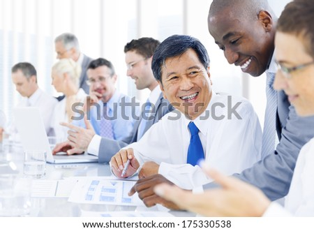 Multi-ethnic group of business people meeting - stock photo
