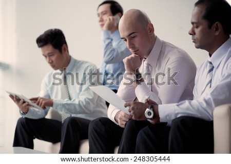 Multi-ethnic group of businessmen working in the office