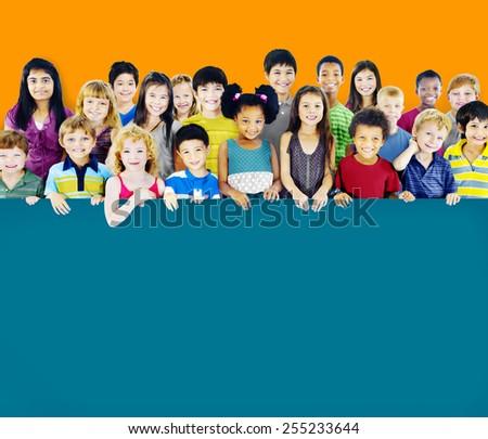 Multi-Ethnic Group of Children Holding Empty Billboard - stock photo