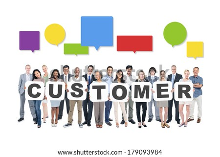 Multi-Ethnic Group Of Contemporary Business People Holding Boards with Customer and Speech Bubbles - stock photo