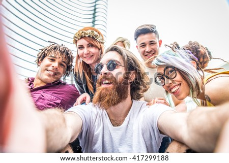 Multi-ethnic group of friends taking a selfie - People of several diverse ethnics and style having fun and partying
