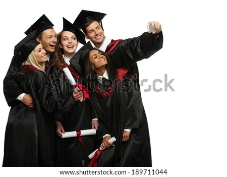 Multi ethnic group of graduated young students taking selfie  - stock photo