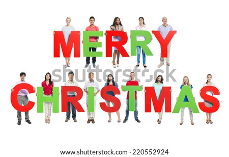 """Multi-ethnic group of people holding """"MERRY CHRISTMAS"""" letters - stock photo"""