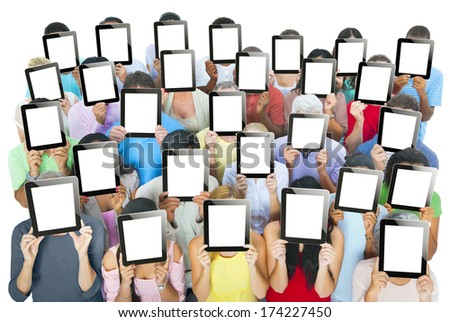 Multi-ethnic group of people holding tablets in front of the faces - stock photo