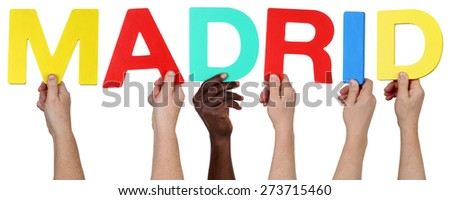 Multi ethnic group of people holding the word Madrid isolated - stock photo