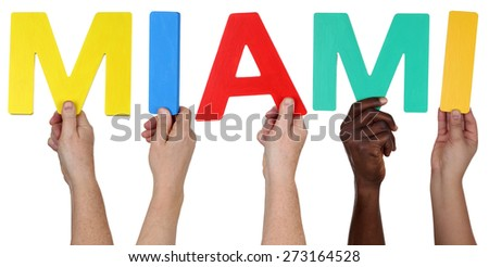 Multi ethnic group of people holding the word Miami isolated - stock photo