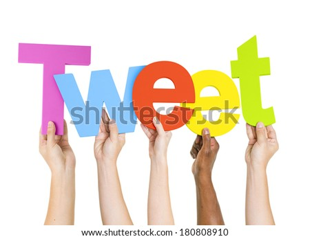 Multi-Ethnic Group Of People Holding The Word Tweet - stock photo