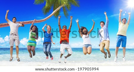 Multi-Ethnic Group of People Jumping by the Beach - stock photo