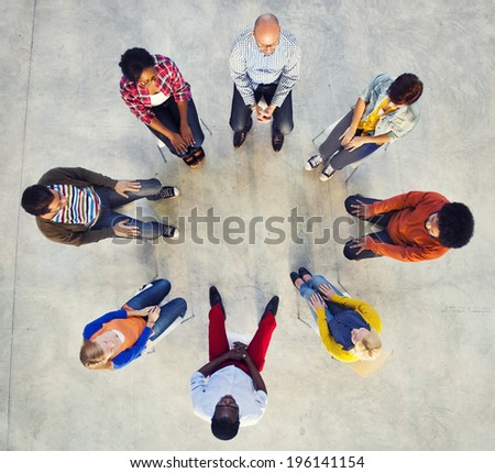 Multi-Ethnic Group of People Sitting in Circle - stock photo