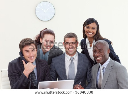 Multi-ethnic group of people smiling in a business meeting - stock photo