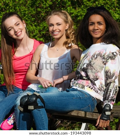 Multi ethnic group of sporty teenage girls in a park - stock photo