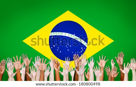 Multi-Ethnic Hands With Flag Of Brazil - stock photo
