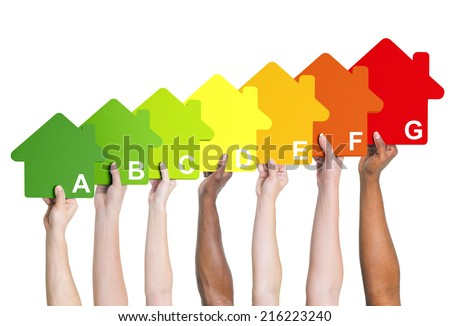 Multi-ethnic people holding house energy graph.