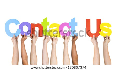 Multi Ethnic People Holding Words Contact Us - stock photo