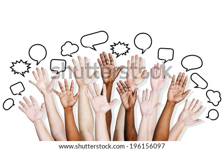Multi ethnic people's hands raised with speech bubble.