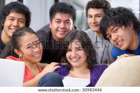 Multi-ethnic students in pose together showing their youthful and friendship
