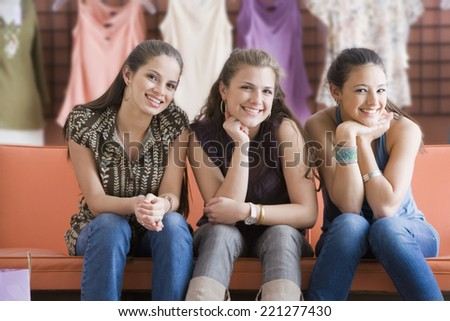 Multi-ethnic teenaged girls at clothing store - stock photo