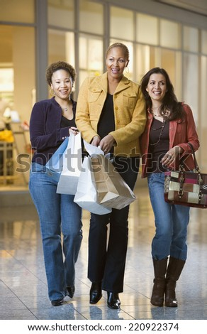Multi-ethnic women with shopping bags - stock photo
