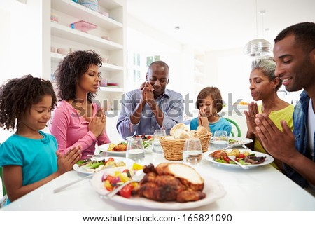 Multi Generation African American Family Praying At Home - stock photo
