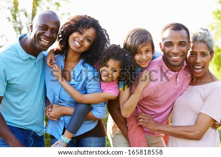 Multi Generation African American Family Standing In Garden - stock photo