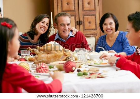 Multi Generation Family Celebrating With Christmas Meal - stock photo
