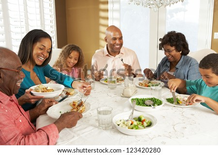 Multi Generation Family Enjoying Meal At Home - stock photo
