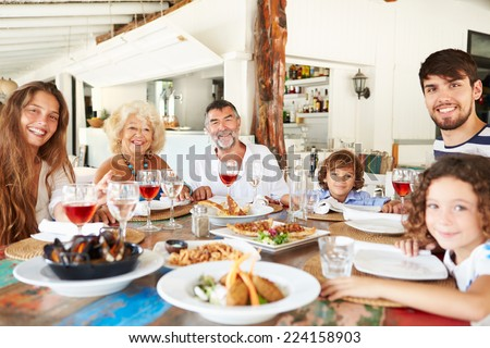 Multi Generation Family Enjoying Meal In Restaurant