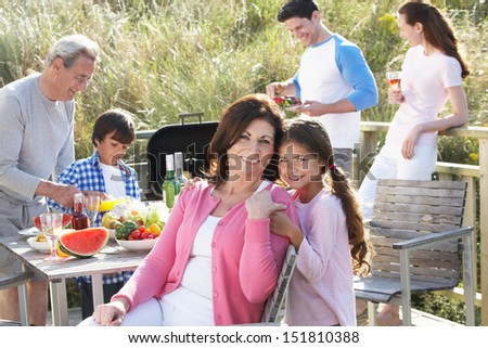 Multi Generation Family Having Outdoor Barbeque - stock photo