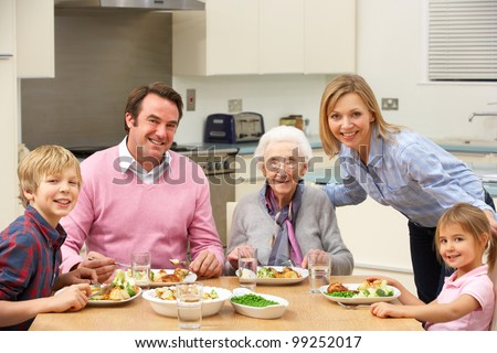 Multi-generation family sharing meal together