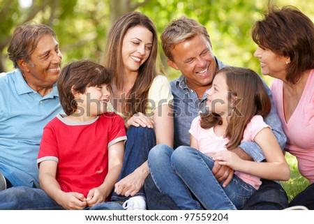Multi generation Hispanic family in park - stock photo