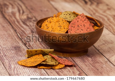 Multi Grain Flax Seed Tortilla Chips In A Wooden Bowl