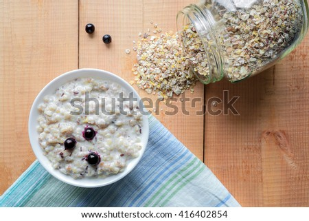 Multi grains porridge with fresh berries. Uncooked whole grain, rolled oats. Top view - stock photo