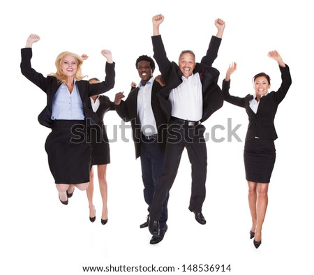 Multi-racial Group Of Business People Raising Arm Over White Background - stock photo
