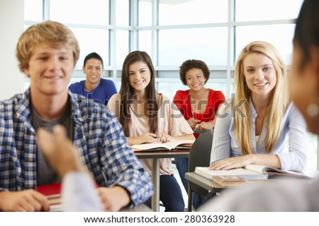 Multi racial teenage pupils in class - stock photo