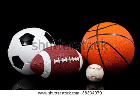 Multi sports balls on a black background - stock photo