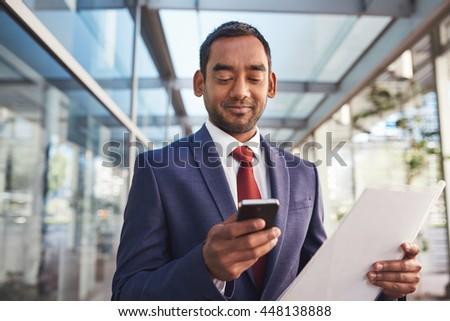Multi tasking and the modern businessman - stock photo