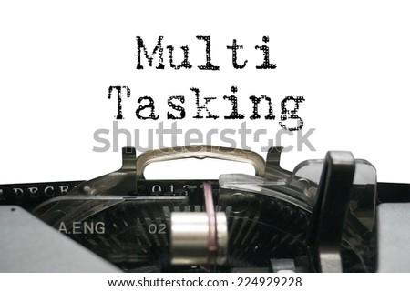 Multi Tasking on typewriter - stock photo