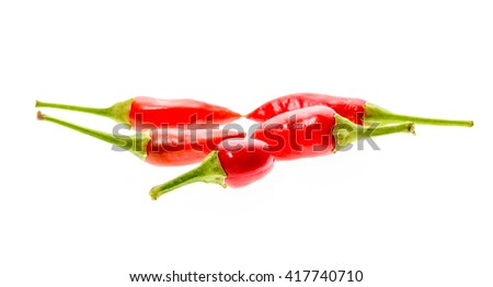 Multible different Red hot chili peppers Cayenne, Serrano with green stem. Cayenne, Serrano or Sicilian variety of chili. Studio image Isolated  on white background. - stock photo