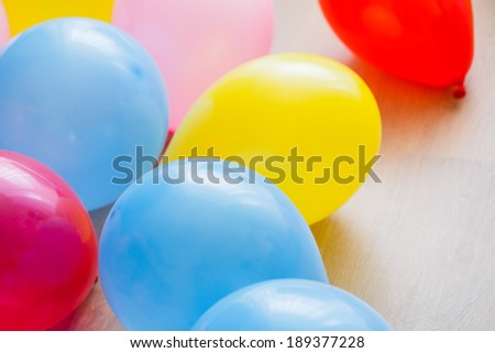 Multicolor balloons on a white floor - stock photo