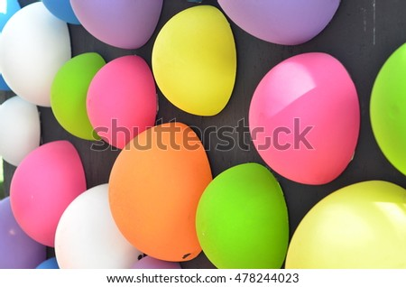 Multicolor balls on black background closeup colorful balls