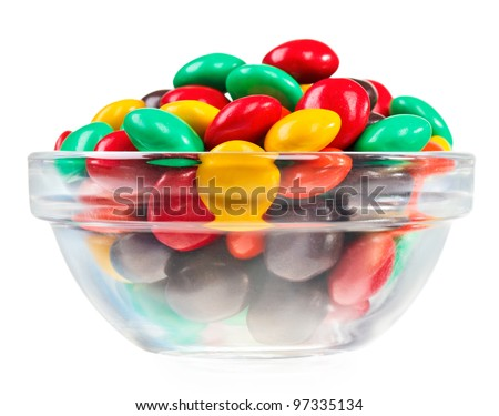 Multicolor bonbon sweets (ball candies) in glass bowl, isolated on white