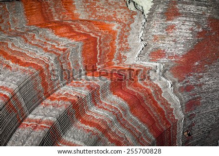 multicolor fragment of wall in potassium salt mine with stripes - stock photo