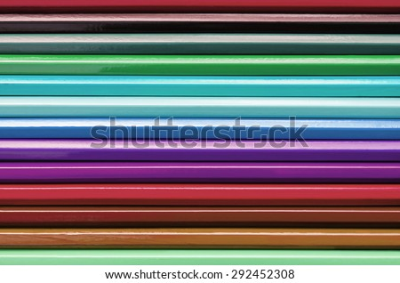 Multicolor of Crayons Colored Pencils Wooden Wallpaper Abstract Rainbow Texture Background Dark Tone - stock photo